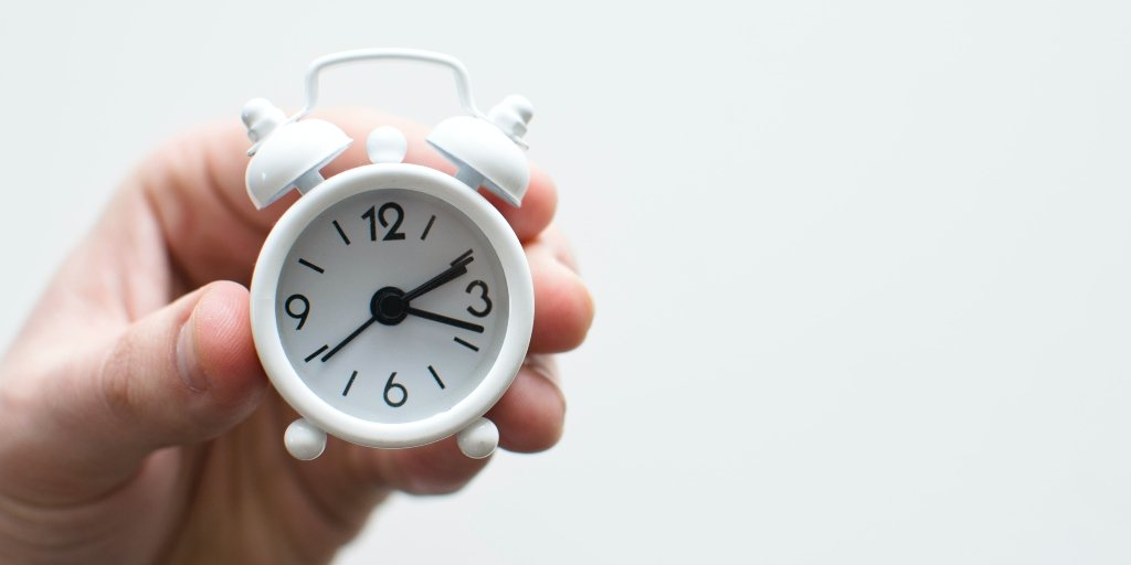 A person holding a clock